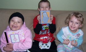 Kids with notebooks from Debbi